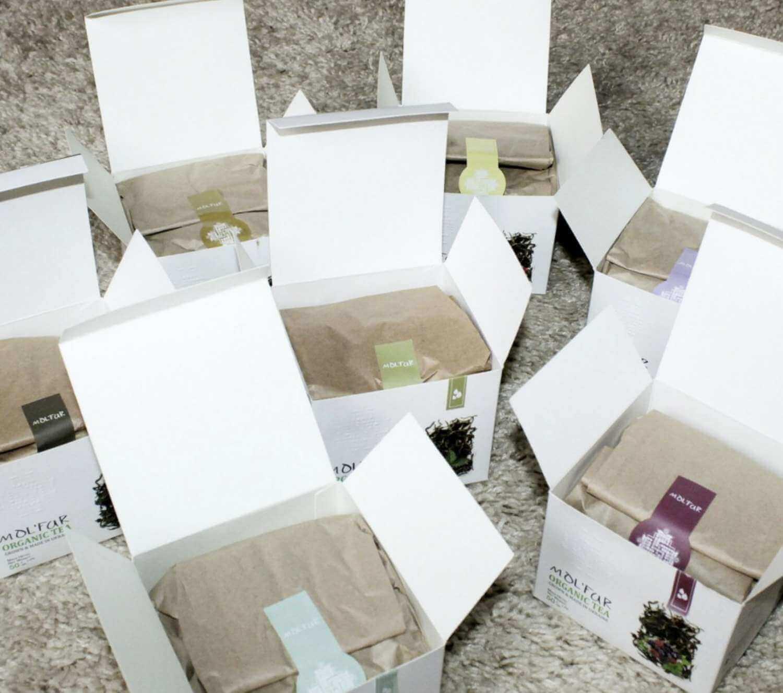 Відкриті коробки чаю Molfar